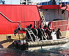 Australian Customs Service staff board the IUU boat, Viarsa, caught stealing Patagonian toothfish in the Southern Ocean in 2003.
