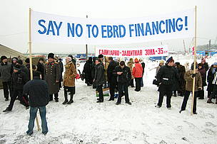 "A group of people holding a banner with the words ""Say No to EBRD Financing""  	© Sakhalin Environment Watch"