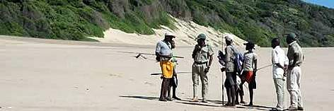 Project Monitor July Ngubane inspects the catch. July flagged-down this group of fishermen to ... rel=