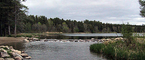 The source of the Mississippi River on the edge of Lake Itasca in Itasca State Park, Minnesota, US.  rel=