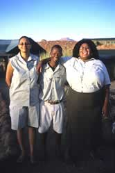 Pascoleno Florry, Damaraland Camp, at right, with members of her staff from the Torra Conservancy. / ©: WWF / Jan Vertefeuille