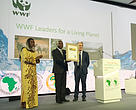 Donald Kaberuka, President, African Development Bank receives the WWF Leader for a Living Planet award presented by Marco Lambertini, WWF Director General at the 2015 AfDB Annual Meetings in Abidjan, Cote d'Ivoire. Looking on is Hawa Sow, WWF Africa Institutional Partnerships Lead.