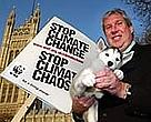 Husky puppy held by UK Environment Minister Elliot Morley at WWF-UK's campaign launch in London.