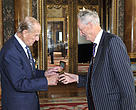 HRH The Duke of Edinburgh presenting the 2014 award to Lord Cranbrook at Buckingham Palace in London.
