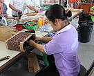 Making rattan handbags in Banxay