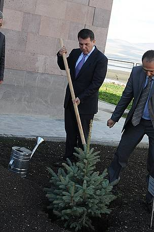 Minister of Nature Protection is planting tree