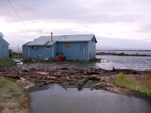 A home sits perilously close to the water's edge. Unalakleet, Alaska.  	© Native Village of Unalakleet