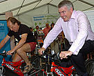 Welsh Environment Minister Carwyn Jones (right) and WWF Wales Head Morgan Parry take part in the Pedal for the Planet challenge.