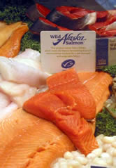 MSC- certified Alaska salmon on fresh fish counter.  	© Whole Foods
