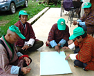Yak herding community members engaged in a group work on conserving Snow Leopards