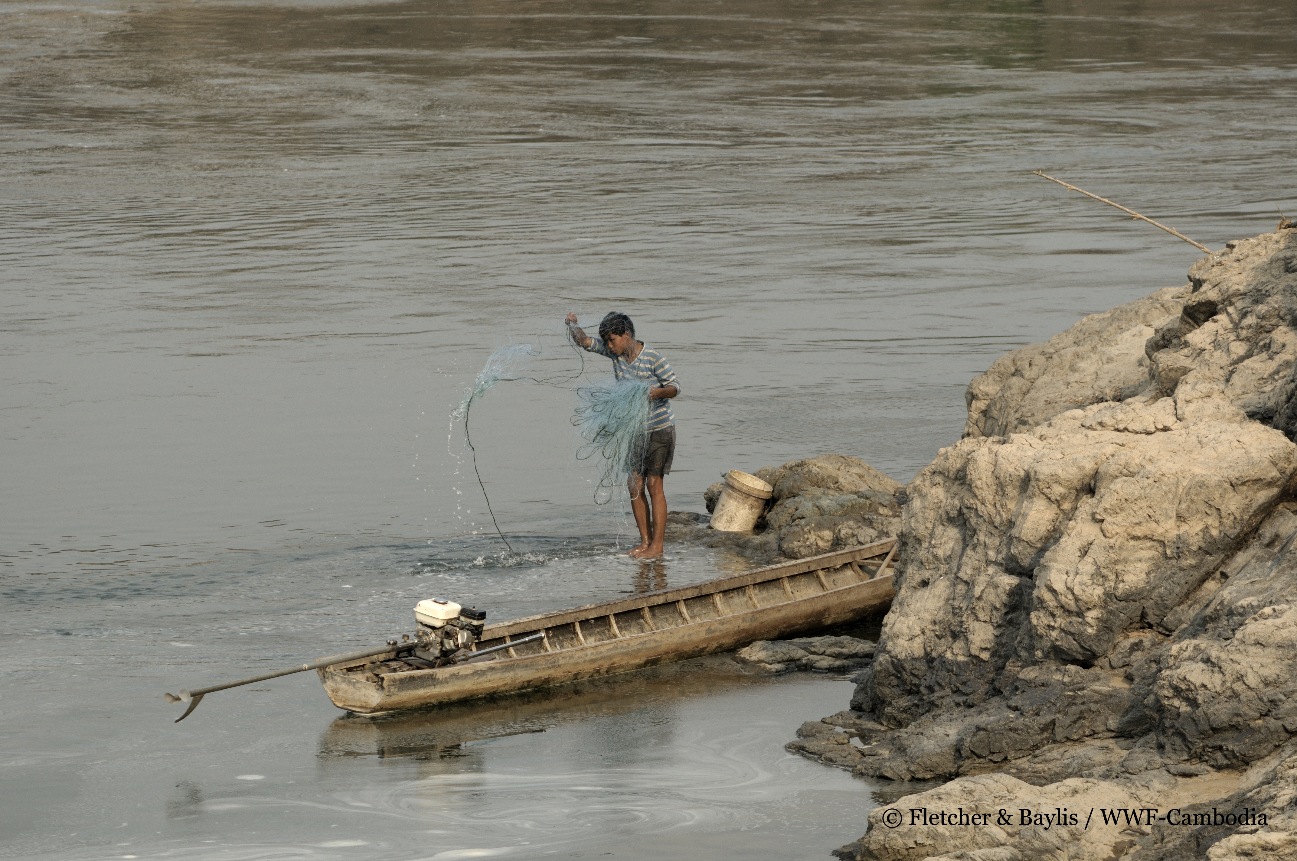 Flawed dam impact assessment gambles with fate of mekong for People catching fish