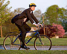 businessman bikes to work