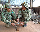 Rangers demonstrating a snare, Cambodia.