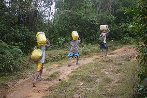 The hour long uphill trek through the forest to carry home water