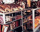 A souvenir shop in Indonesia selling pangolins (top left).