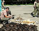 WWF officer ........... inspecting part of the haul from the well-executed Khanka Lake interception of smugglers by Russian far east authorities.
