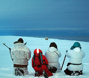 The Polar Bear Patrol watch a large male polar bear about 200 metres away.       © Tom Arnbom