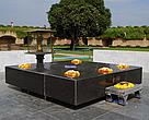 Raj Ghat, the sight where Gandhi has been laid to rest marked by an eternal burning flame