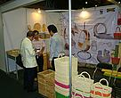 Potential buyer visiting rattan booth.