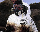 WWF-Spain volunteer cleaning up following the <I>Prestige</I> oil spill.