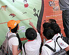 Vietnamese schoolchildren learning about wildlife trade at the opening of WWF-TRAFFIC's new travelling exhibition. Hanoi, Vietnam.