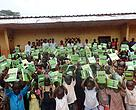 Pupils of Government primary school Mambele in East Region of Cameroon brandish books donated by WWF to promote learning and knowledge on hand washing
