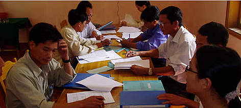 Park managers filling out the RAPPAM questionnaire in Bach Ma National Park, August 2004. rel=