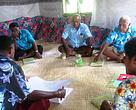 Ratu Alifereti Rabukawaqa (next to the door) during a Group Discussion in Somosomo village