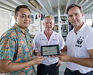 "Ken Katafono, TraSeable Solutions CEO, Brett ""Blu"" Heywood, SeaQuest Fiji CEO and Dermot O'Gorman WWF-Australia CEO showing the blockchain data that records the start of the traceability journey. At the docks, Walu Bay, Suva, Fiji, December 2017."