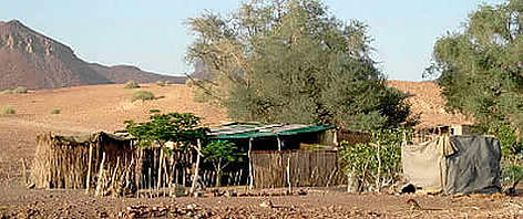 Rural dwelling on outskirts of Tora Conservancy, Kuene region, Namibia. rel=