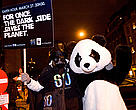 Darth Vader and a WWF Panda celebrate the Earth Hour 'Hopenhagen' event. The lights of the host city were turned out as approximately 1000 children took part in a special lantern parade to help deliver the hopes and dreams of the World for a meaningful agreementt at COP 15, United Nations Climate Change Conference, Copenhagen, Denmark, 2009.