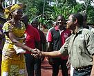 Fred shakes hands with representatives of women conservation group near Lobeke National Park