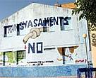 Protest against the SNHP painted on the wall of an abandoned house in the Ebro delta.