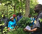Soyi, a model farmer explaining to the visiting team about the SLM practices in his garden.