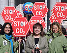 WWF Spain staff meeting Environment Minister Cristina Narbona. 23 STOP signs symbolise the 23 million tons of CO2 WWF Spain demands its industry to cut.