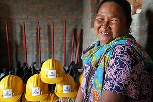 Sugmaya Thapa smiles as she explains the use of forest fire fighting equipment.