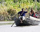 A group of fishermen in their boat in the Sundarbans National Park, Bangladesh.