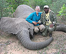 Dr Martin Tchamba (right) with Dr Mike Loomis shortly before being trampled by a tagged elephant.