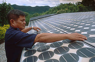 A solar panel is one way of helping curb climate change.     	© WWF/ Adam OSWELL