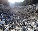 Excavators modify the riverbed to build dikes in Pirin National Park. Modification of riverbeds in national parks is forbidden by law.