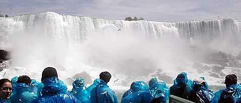 Tourists enjoying the magnificent view of the Niagara Falls. rel=