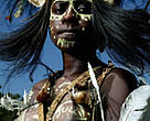 Local woman in traditional dress in Rhoku village, by a tributary of the Bensbach River. Her headdress is made from the feathers of the Cassowary - Papua New Guinea's largest bird, and she is adorned with white palm cockatoo feathers. Western Province, Papua New Guinea. December 2004