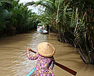 Local woman rowing a boat on a branch of the Mekong river near My Tho, south Vietnam.