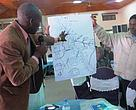 Water stakeholders around Ruaha perusing the upstream/ downstream community water access diagram