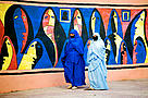 Muslim women wearing the traditional chador or nikab. Streets in the town of Taroudannt, Morocco.