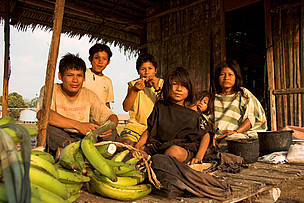 An Ashaninka family with bananas harvested from the adjacent cultivations. Ucayali Province, Peru.