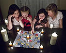 Earth Hour 2009 - A family playing a board game by candlelight. Toronto, Ontario, Canada.