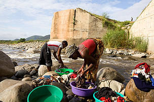 People washing in the river, Rwenzori Mountains, Uganda.