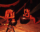 Yanomami preparing meal. The Yanomami indians have been adversely affected by the forest fires in the Amazon, they are already facing difficulties enough to keep their traditional lifestyle. Amazon, Brazil