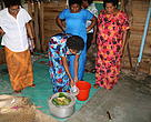 Navotua women preparing the assimilation cooler technique for food preservation